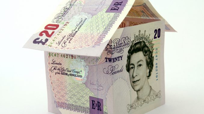 Pound notes folded into the shape of a house symbolize the UK governments bailout of the financial sector in 2008. The Government has just announced it will sell £3bn in home mortgages acquired from Bradford & Bingley.
