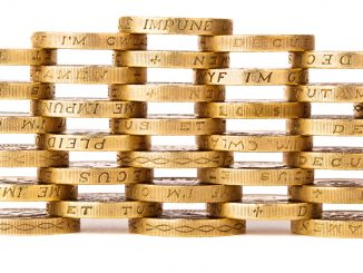 A stack of British pounds symbolizes the 1.2bn debt the Nest Corporation will owe the British Government by 2026.